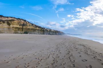 Cliff and wild beach in Sesimbra, close to the Cape Espichel. Po