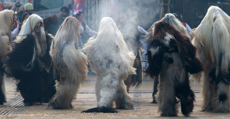 Aluminium Prints Eastern Europe PERNIK, BULGARIA - JANUARY 29, 2017 - Masquerade festival Surva in Pernik, Bulgaria. People with mask called Kukeri dance and perform to scare the evil spirits