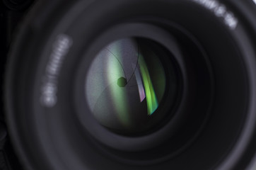 Camera lens close-up on white background