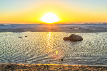 Calm sea at sunset with golden background and copy space. Noordoek Beach in Table Mountain National Park, Cape Town, South Africa. Peace, relaxation, summer, holidays concept.