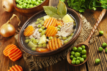 Soup with green peas and meat