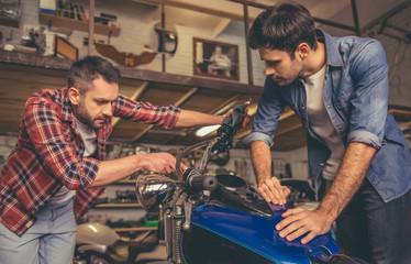 Guys at the motorbike repair shop