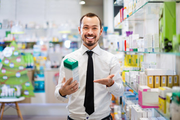 Smiling male customer looking for right medicine