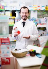 Smiling man medicine offer showing right drug