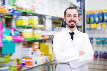 Glad pharmacist showing assortment