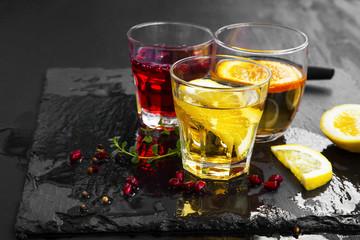Cocktails glasses with lemon, orange and pomegranate