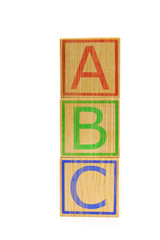 Stacked brown wooden ABC letter cubes