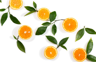 Slices of orange fruits and green leaves.