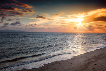 Wall Mural - Beautiful seascape. Sunset on the shore of a tropical sea