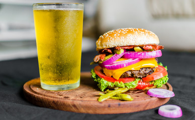 Burger and beer. Selective focus