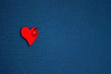 red heart on blue background, valentine's day concept