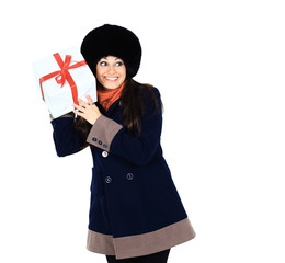 Beautiful woman with a gift in the hands, trying to guess what's in the box