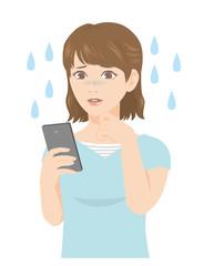 スマホを持つ女性 悲しみ