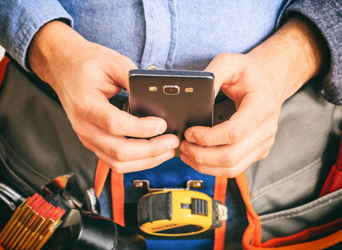 Worker holding a smartphone