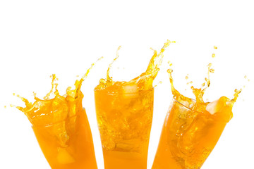 Orange juice splashing out of glass., Isolated white background with copy space.