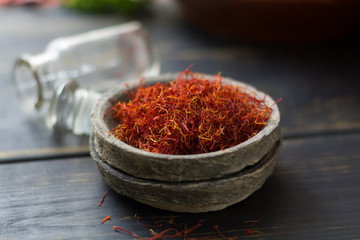 Raw Organic Red Saffron Spice in a clay bowl