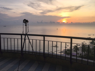 camera take sunrise picture over sea and beach at Hua Hin, Thailand
