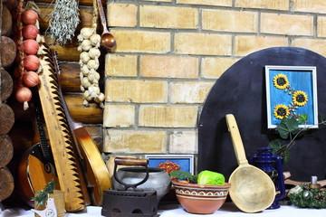 Pigtail with onion and garlic, vintage Washing board, iron, bandura. Ancient traditional Ukrainian lifestyle
