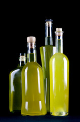 group of bottles of sorrento limoncello homemade, black background