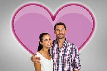 Composite image of portrait of smiling couple looking at camera