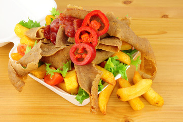Doner Kebab Meat And Chips In A Take Away Box
