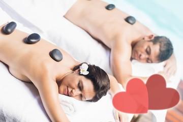 Composite image of a couple receiving a massage