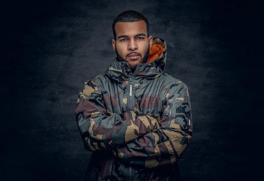 Black man dressed in military jacket.