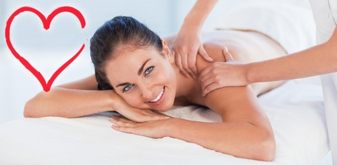 Composite image of smiling woman on massage table