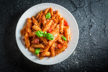 Hot pasta bolognese with parmesan and basil