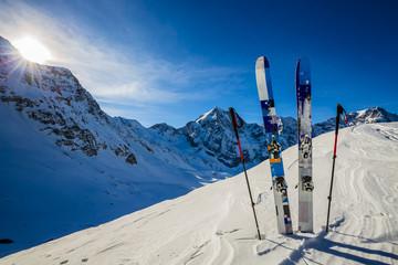 Ski in winter season, mountains and ski touring backcountry equi