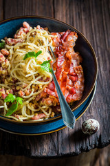 Enjoy your spaghetti Carborana made of becon, eggs and parsley