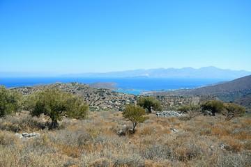 Elevated view of Elounda with views across the sea towards the island of Spinalonga, Elounda, Crete.