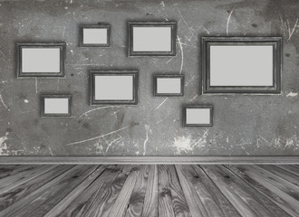 Interior with set of empty photo frames on grungy wall backgroun