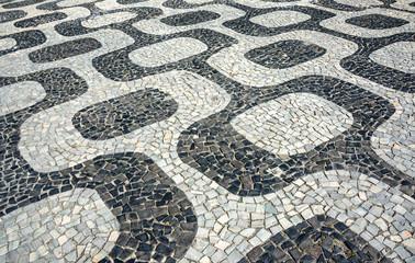 Black and white iconic mosaic, Portuguese pavement by old design pattern at Ipanema beach, Rio de Janeiro, Brazil