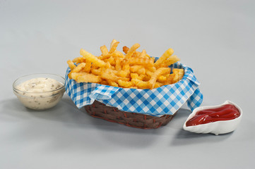 French fries with ketchup and sauce