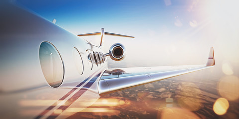 Business travel concept.Generic design of white luxury private jet flying in blue sky at sunset.Uninhabited desert mountains on the background.Horizontal,flares effect. 3D rendering Wall mural