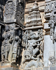 Ancient temple at Halebidu in India has well crafted carvings on its walls. This is of Lord Ganesh equipped with arms in his multiple hands, crippling the demon under his leg.