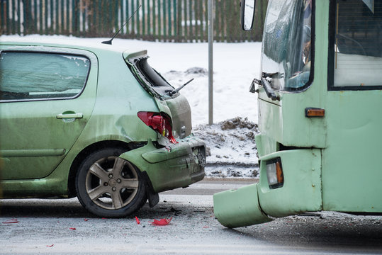 Accident on the winter road, smashed car