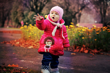 A small child posing in the park