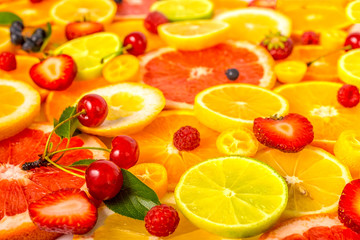 beautiful fresh sliced mixed citrus fruits as background with di