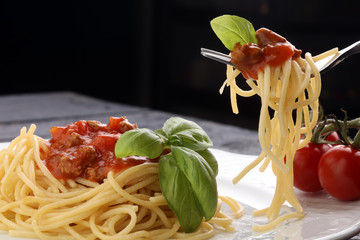 Plate of delicious spaghetti Bolognaise or Bolognese with savory