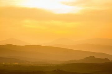 Tuinposter Ochtendgloren Rolling rural landscape at sunset
