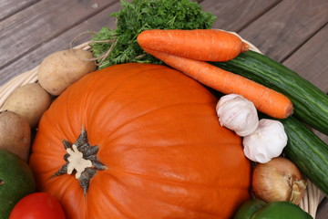 Fall harvest - big basket with pumpkin and vegetables