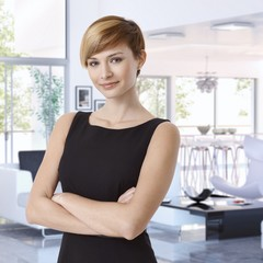 Attractive young businesswoman at designer home