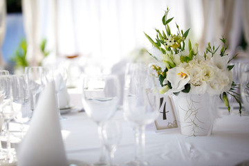 white flowers decoration on the dining table