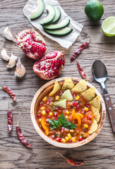 Mexican tortilla soup on the wooden background