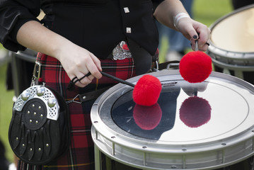 Playing the drums in a Scottish Pipe Band.
