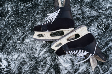 hockey scates on ice pond riwer