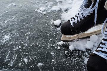 hockey scates on ice pond riwer