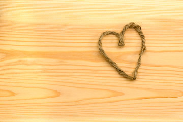 Heart handmade thread on a wooden board